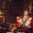 Russian beauty before Christmas in a wooden interior — Stock Photo