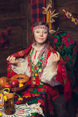 Russian beauty in a wooden interior — Stock Photo