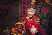 Russian beauty girl in a wooden interior — Stock Photo