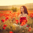 The bride  in a poppy field — Stock Photo