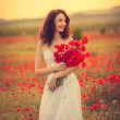 Bride in poppy field — Stock Photo #26400883