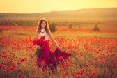 The girl in a poppy field — Stock Photo