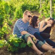 Family in the striped shirt in the vineyard — Стоковая фотография