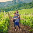 Family in the striped shirt in the vineyard — Stock Photo