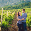 Couple in striped shirts in the vineyard — Stock Photo