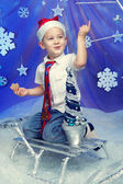 A kid pointing finger in Santa's hat — Stockfoto