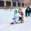 Family playing outdoors in the winter — Stock Photo