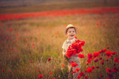 A boy with a bouquet of poppies — Photo