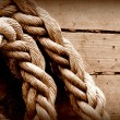 Old texture of wooden boards with ship rope — Stockfoto