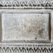 Old marble slab with carved frame - Stock Photo
