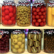 Various preserved fruits and vegetables in jars — Stock Photo #13175963