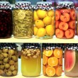 Various preserved fruits and vegetables in jars — ストック写真
