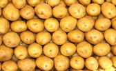 Potatoes on the market stand — Stock Photo