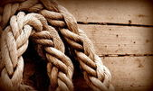 Old texture of wooden boards with ship rope — Foto Stock