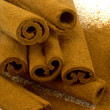 Grounded cinnamon on cinnamon sticks — Stock Photo
