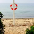 Life buoy on the beach — Stock Photo