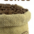 Roasted coffee beans in a flax bag and sample text — Stock Photo #13524984