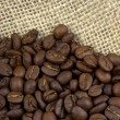 Coffee beans on linen burlap — Stock Photo