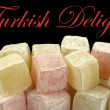 Turkish delight and sample text on black background — Stock Photo