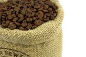 Roasted coffee beans in a flax bag — Stock Photo