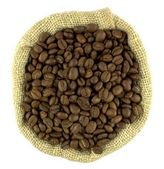 Coffee beans and linen sack . Top view — Stock Photo
