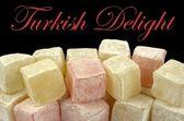 Türkisch Delight und Beispiel-Text auf schwarzem Hintergrund — Stockfoto