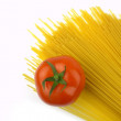 Royalty-Free Stock Photo: Uncooked spaghetti and tomato