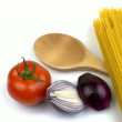 Spaghetti, tomato, red onion  and wooden spoon — Stock Photo