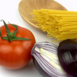 Stock Photo: Spaghetti, tomato, red onion and wooden spoon