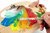 Artist palette , colors and paintbrushes — Stock Photo