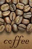 Granos de café sobre fondo marrón — Foto de Stock