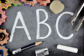 ABC letters and school stuff on blackboard. Education concept. — Stock Photo