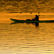 Silhouette kayaking at sunset — Stock Photo