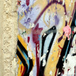 Part of the Berlin Wall and detail of graffiti - Stock Photo