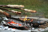Campfire and bread baking — Stock Photo