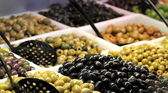Various olives on market stand — Stock Photo