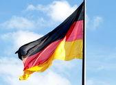 Mává německá vlajka — Stock fotografie