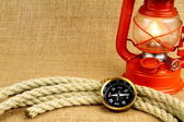 Old compass, oil lamp — Stock Photo