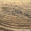 Old wood texture with  organic  stamp text — Foto Stock