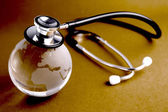 Stethoscope and crystal globe - — Foto Stock