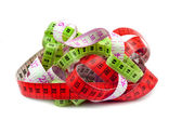 Various entangled measuring tape. — Stock Photo