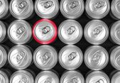 Aluminum drink cans and one red can. — Stock Photo