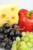 Cheese, red pepper and grapes — Stock Photo
