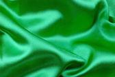 Green wavy silk fabric — Stock Photo