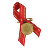 Turkish traditional gold coin with red ribbon — Stock Photo