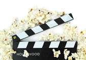 Popcorn and movie clapper — Stock Photo