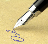 Fountain pen writing on the paper, macro shot. — Stock Photo