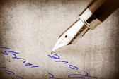 Fountain pen writing on the paper, — Stock Photo