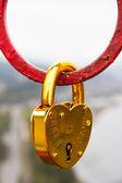 Heart shaped love padlock - beautiful wedding day custom. — Stock Photo