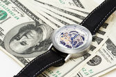 100 dollars on white background with wristwatches — Stock Photo